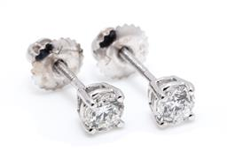 Sale 9253J - Lot 485 - A PAIR OF 18CT WHITE GOLD SOLITAIRE DIAMOND STUD EARRINGS; each set with a round brilliant cut diamond, 2 totalling 0.62ct, G/P1 on...