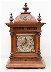 Sale 8644A - Lot 23 - A Continental oak bracket clock with Arabic numerals, height 43cm, with loose finial, in working order with key, chimes on the hour...
