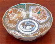 Sale 9055H - Lot 50 - A Japanese shaped lobe formed shallow bowl with imari decoration externally, the interior with four-panelled cartouches encircling...