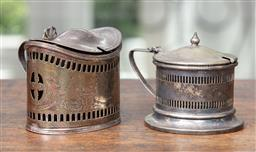 Sale 9120H - Lot 90 - A hallmarked Irish sterling silver mustard pot with blue glass liner together with a plated example (missing liner), silver Weight 9...