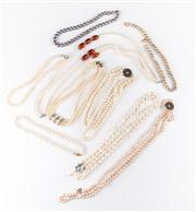 Sale 8774A - Lot 392 - A large assortment of freshwater cultured pearl necklaces with various claps, some multi strand