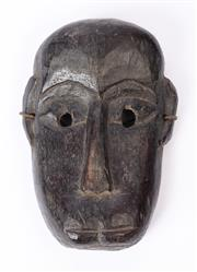 Sale 8994H - Lot 42 - A timber carved mask showing age, height 24cm -