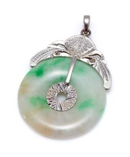 Sale 9213 - Lot 331 - A JADE BI PENDANT; 26mm round jade disc with silver fittings, length 40mm.