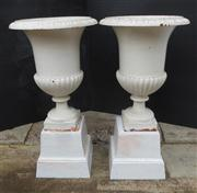 Sale 8272A - Lot 85 - A pair of painted white Antique French cast iron garden urns on stands four pieces. Overall Ht: 86 x 46 cm