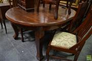 Sale 8472 - Lot 1043 - Timber Seven Piece Dining Setting incl. Round Top Table on Castors with Single Leaf & Six Rail Back Chairs (Winder in Office)