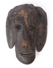 Sale 8994H - Lot 41 - A timber carved mask showing age, height 30cm -