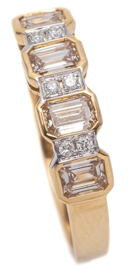 Sale 9177 - Lot 378 - AN 18CT GOLD QUARTER HOOP DIAMOND RING; rub set with 4 emerald cut diamonds totalling approx. 0.76ct SI, between 6 round brilliant c...