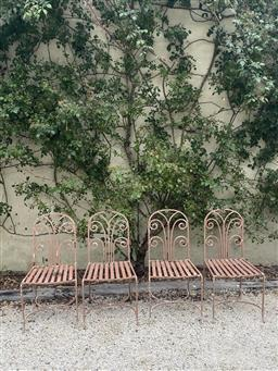 Sale 9135H - Lot 58 - A set of four art deco style, Mid 20th Century iron chairs. 85cm Height