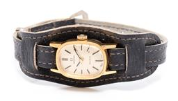 Sale 9253J - Lot 489 - A VINTAGE OMEGA LADYS MANUAL WRISTWATCH; gold tone dial with baton markers in gold plated case, on later band, plus Omega buckle, w...