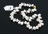 Sale 3724 - Lot 18 - A STRAND OF PEARLS SET BETWEEN TAPERED ROSE QUARTZ BEADS.