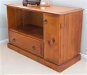 Sale 8562A - Lot 157 - A pine entertainment cabinet of diminutive size, with single door and drawer, H 60 x W 95 x D 41cm