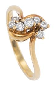 Sale 8937 - Lot 410 - AN 18CT GOLD DIAMOND RING; claw set with a scroll form cluster of 7 round brilliant cut diamonds, size M, wt. 2.54g.