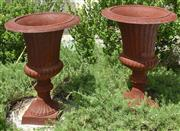Sale 8950G - Lot 11 - Pair of fluted cast iron urns. 57cm height