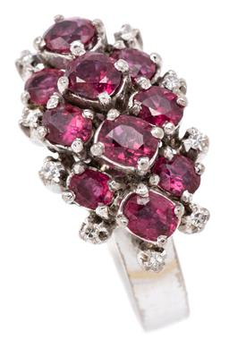 Sale 9132 - Lot 366 - A GEMSET COCKTAIL RING; 19 x 12mm cluster top set with oval cut rubies and single cut diamonds, tests 6ct white gold, size M, wt. 6....