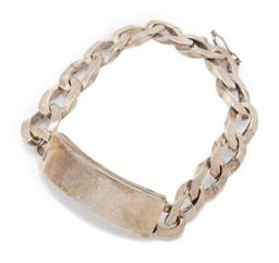 Sale 9186 - Lot 390 - A GENTS HEAVY SILVER ID BRACELET; 10mm wide curb links to uninscribed name plate to integrated clasp, length 19cm, wt. 47.80g.