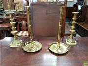 Sale 8598 - Lot 1039 - Two Pairs of Brass Candle Sticks, the tall pair with eject lever, the others with turned faceted shafts