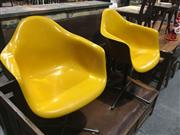 Sale 8740 - Lot 1530 - Pair of Yellow Moulded Tub Chairs