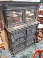 Sale 8956 - Lot 1038 - Late 19th Century Flemish Carved Oak Sideboard, the short top with two mirror panel doors, with arcaded panel doors below. (H:174 x...