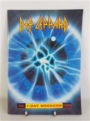 Sale 8960M - Lot 31 - Def Leppard - The 7-Day Weekend Tour Brochure