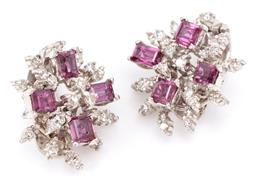 Sale 9132 - Lot 364 - A PAIR OF 9CT WHITE GOLD GEMSET EARRINGS; each a snowflake style cluster set with 3 square and a baguette cut ruby surrounded by sin...