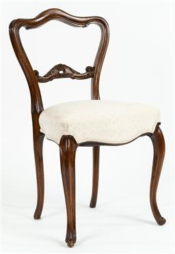 Sale 9099 - Lot 236 - A single carved occasional chair with fabric seat raised on slender cabriole legs. Height of back 84cm
