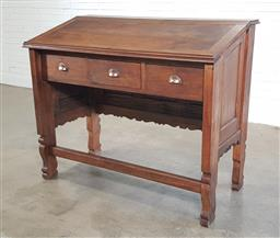 Sale 9196 - Lot 1037 - Late 19th/ Early 20th Century Clerks Desk, the hinged sloping top missing insert, above three frieze drawers and shaped apron, havi...