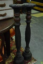 Sale 8566 - Lot 1703 - Pair of Turned Candle Holders (100.5)