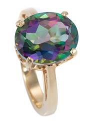 Sale 8937 - Lot 455 - A 14CT GOLD TOPAZ RING; four claw set with an oval cut mystic topaz of approx. 5.8ct, to pierced gallery and shoulders, size L, wt....