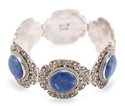 Sale 9169 - Lot 361 - A VINTAGE SILVER FILIGREE LAPIS BRACELET; 6 x 28mm wide plaques with bead and wire work each centre set with a 14mm round cabochon l...