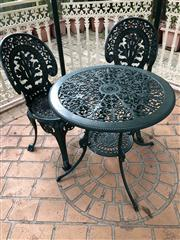 Sale 8774A - Lot 397 - A cast iron three piece outdoor setting powdercoated in brunswick green, H x 64cm