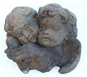 Sale 8312A - Lot 30 - A vintage cast stone wall plaque of two cherubs, size 27 x 30 cm