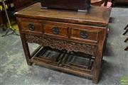 Sale 8500 - Lot 1097 - Chinese Elm Side Table with Three Drawers, Carved Apron and Stretcher Base