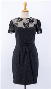 Sale 8891F - Lot 53 - An Alex Perry charcoal crepe sheath dress with lace paneling to the bodice and sleeves, size 10