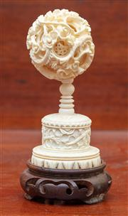 Sale 9055H - Lot 51 - An ivory puzzle ball on a timber stand. Total height: 16cm.