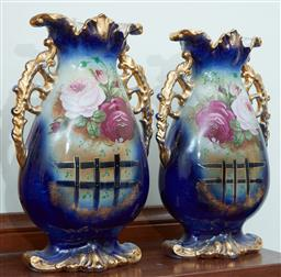 Sale 9103M - Lot 567 - A pair of blue ground continental vases with floral decorations and gilt handles, Height 39cm, chip to one