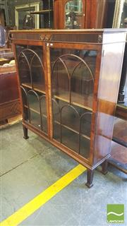 Sale 8402 - Lot 1083 - Georgian Style Mahogany Bookcase, with decorative frieze, two astragal doors enclosing timber shelves & square tapering legs (Key in...