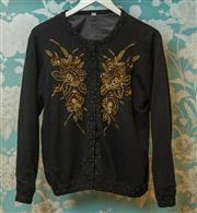 Sale 8420A - Lot 87 - A vintage black beaded 100% cashmere cardigan, size: 42 (L), featuring gold & black beaded flower detail along the front, cuffed sle...