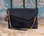 Sale 8474A - Lot 77 - A designer Henri Bendel black leather clutch purse featuring striking gold hardware & fuscia satin lining - Condition: very good - S...