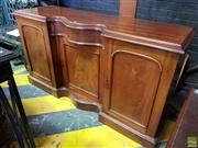 Sale 8617 - Lot 1079 - 19th Century Cedar Sideboard, with serpentine drawer & three panel doors (Key in Office)