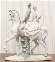 Sale 8881H - Lot 36 - A Lladro figure of a pair on horseback, Height 46cm.