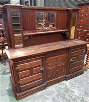 Sale 8939 - Lot 1069 - Late 19th Century Walnut Sideboard for a Commercial Bar, with mirror back & side cupboards, above a drawer, fall-front and two panel...