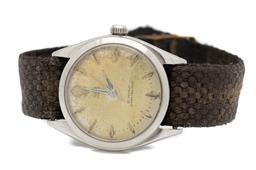 Sale 9186 - Lot 392 - A VINTAGE TUDOR OYSTER WRISTWATCH; ref. 7934 in stainless steel no. 340814, patinated dial, center seconds, 21 jewel ETA cal 1156 ma...