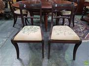 Sale 8617 - Lot 1029 - Set of Six + One Regency Mahogany Chairs, all with rope backs and floral embroidered seats, the armchair with turned legs, the other...