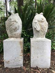 Sale 8706A - Lot 34 - A vintage pair of carved stone fish statue / finial, general wear, 1 statue has previous old repair of to base of fish, some chippin...