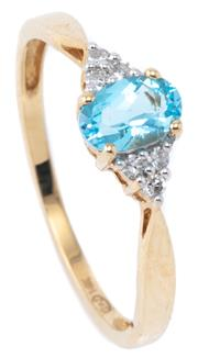 Sale 8982 - Lot 356 - A 14CT GOLD TOPAZ AND DIAMOND RING; centring a blue oval topaz and 6 single cut shoulder diamonds, size N - O, wt. 1.46g.