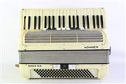 Sale 8940 - Lot 66 - A Cased Hohner Tango III Piano Accordian (Some Losses)