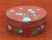 Sale 9055H - Lot 52 - A small cloisonne lidded box decorated with flowers on a russet ground. Character mark to base. W:7cm