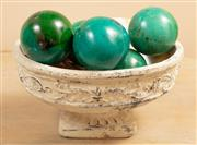 Sale 9071H - Lot 8 - A painted terracotta oval form footed vase containing turquoise spheres and shells, Diameter 29cm