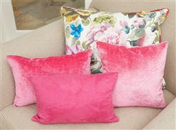 Sale 9108H - Lot 55 - Three hot pink cushions together with a decorative floral cushion.