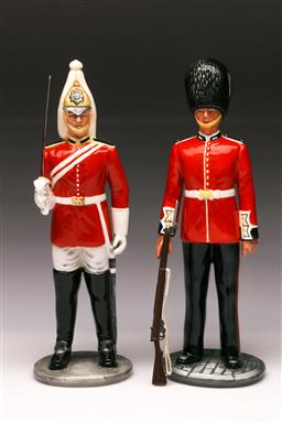 Sale 9110 - Lot 339 - Royal Doulton figures of The Guardsmen HN 2784 - rifle need reattaching - and The Lifeguard HN 2781 (H:26cm)